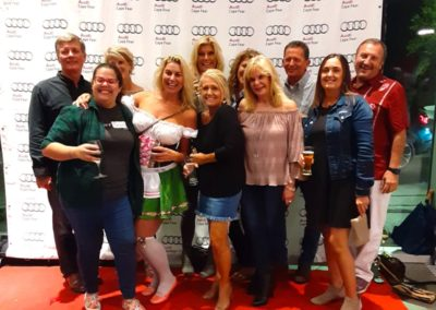 Group photo taken in front of the Audi Cape Fear step and repeat at the 2019 Quattroberfest